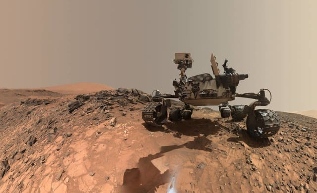 "Low-angle self-portrait of NASA's Curiosity Mars rover.  Taken August 5th, 2015, the image is a composite showing the vehicle and the site where it performed drilling operations, dubbed ""Buckskin"" on lower Mount Sharpe.  Future planetary exploration using nanobots would replace these types of rovers, and provide faster and more detailed mapping, chemical analysis, atmospheric composition and other vital data."