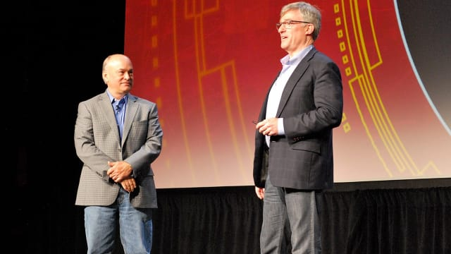 PARTNERS ON STAGE. PTC's visionary leader Jim Heppelmann (left) and Rockwell Automation's, Blake Moret, on stage in connection with a presentation of collaboration plans and work.