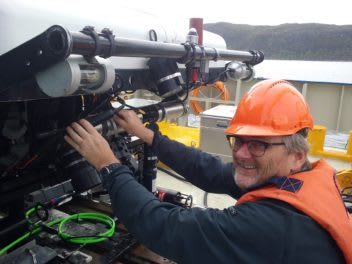 NTNU biologist Geir Johnsen works on a piece of equipment on a remotely operated underwater vehicle (ROV) that was also used on the Runde cruise. (Photo courtesy of Glaucia Fragoso, NTNU.)