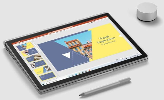 "The Surface Book 3 in ""studio mode"" alongside Surface Pen and Dial. (Image courtesy of Microsoft.)"