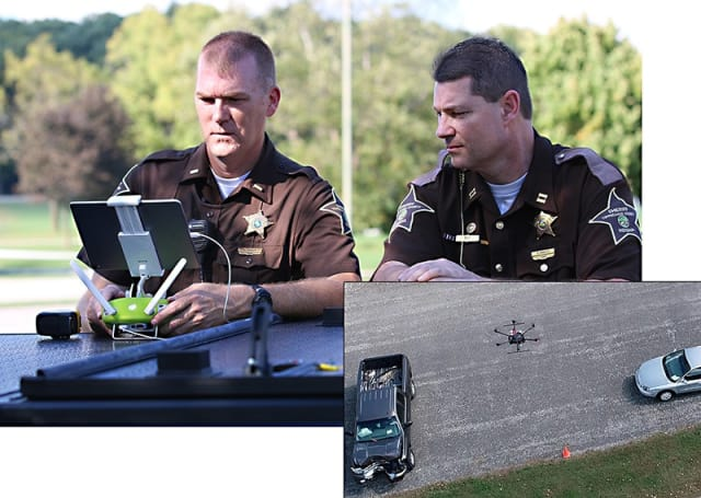 Capt. Rob. Hainje and Capt. Terry Ruley of the Tippecanoe County Sheriff's Office test drone technology for use at vehicular crash sites. The office used the technology to map vehicular crash scenes 20 times in 2018. (Image courtesy of John Bullock and Erin Easterling/Purdue University.)