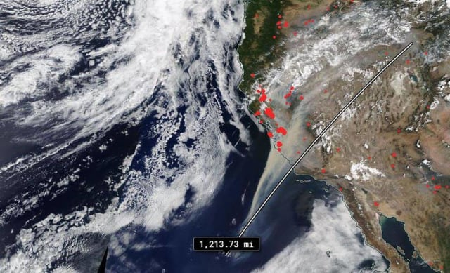 The California wildfire smoke trail is 1,214 miles long. (Image courtesy of NASA Worldview.)