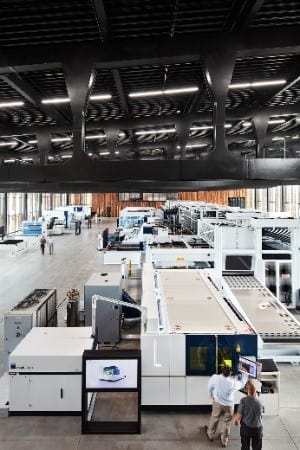 The production hall, 180 feet in length, showcases a sheet metal manufacturing line, with a high storage bay that supplies materials to the machine tools connected to it. (Image courtesy of Trumpf.)