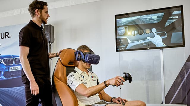 Customers taking the BMW M Virtual Experience could load their preconfigured feature sets and change different aspects of the interior, paint and wheels during the visualization. By sitting in a real M5 car seat mapped into their virtual world, each person could open the passenger door and get inside the 1:1 scaled virtual model. After interacting with the gear shift, rear-view mirror, steering wheel and cabin storage compartments, a start button magically appeared to start the engine and begin the virtual car's motion down the racetrack's starting lights. They turned green and the race began, giving users a virtual ride down a famous track, like Le Mans in France. (Image courtesy of HTC Vive.)