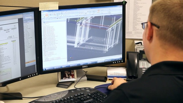 A Schaefer's Electrical Enclosures engineer works with the Solid Edge CAD system to design a standard enclosure.