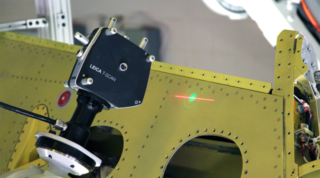 Using a Leica T-Scan to inspect an aerospace component. (Image courtesy of Hexagon.)