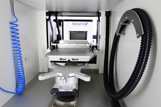 The MetalFAB1 features different modules for automatically implementing different stages in the printing process. (Image courtesy of Additive Industries.)