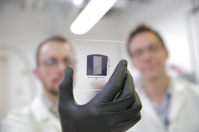 The UW-Madison engineers use a solution process to deposit aligned arrays of carbon nanotubes onto 1 inch by 1 inch substrates. The researchers used their scalable and rapid deposition process to coat the entire surface of this substrate with aligned carbon nanotubes in less than 5 minutes. The team's breakthrough could pave the way for carbon nanotube transistors to replace silicon transistors, and is particularly promising for wireless communications technologies. (Image courtesy of Stephanie Prescourt.)