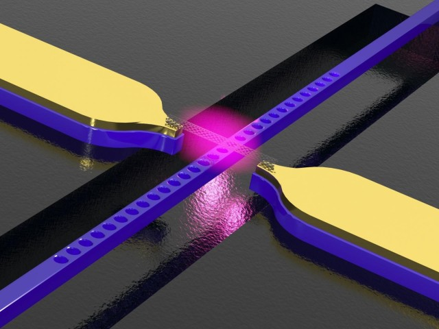 Carbon nanotube above a photonic crystal waveguide with electrodes. The structure converts electric signals into light.