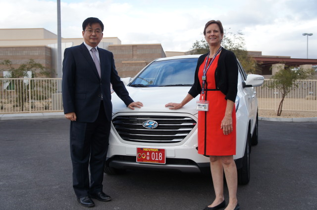 Hyundai vice president Tae-Won Lim and Nevada DMV deputy administrator Robin Allender pose with one of the two Tuscon (ix35) autonomous cars approved for testing. (Image courtesy of Hyundai.)
