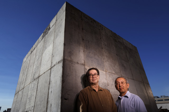 Nebraska engineers Christopher Tuan (left) and Lim Nguyen have developed a cost-effective concrete that shields against damaging electromagnetic energy. (Image courtesy of University of Nebraska-Lincoln.)