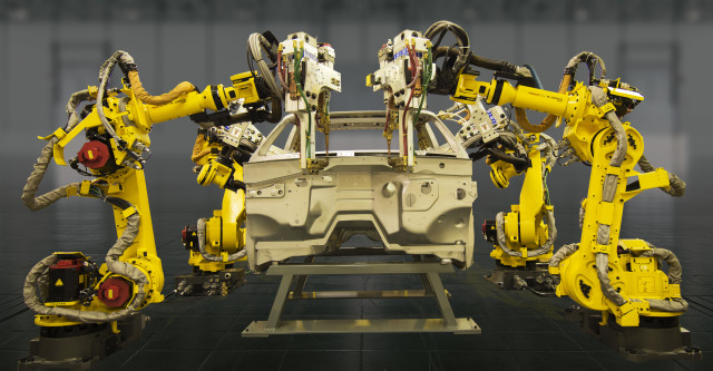 The FANUC canary-yellow industrial robots became famous for being workhouse juggernauts, but they weren't known for being particularly bright. Now these giant industrial robots that make themselves as well as components for themselves are getting some deep learning parallel processing AI brains from NVIDIA. (Image courtesy of FANUC.)