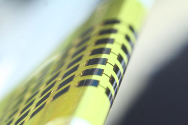 The 1-micron thick solar cells can be bent around objects as small as 1 mm in diameter. (Image courtesy of Juho Kim, et al./Applied Physics Letters.)