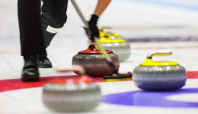 Champion curlers test frankenbrooms at the World Sweep Summit.