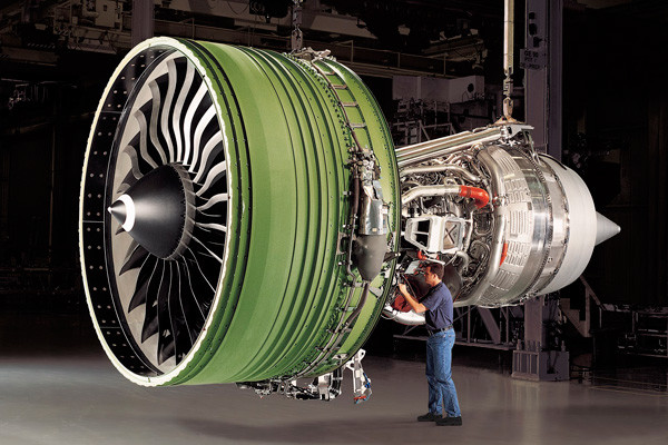 A technician works on a GE90 engine. (Image courtesy of GE Aviation.)