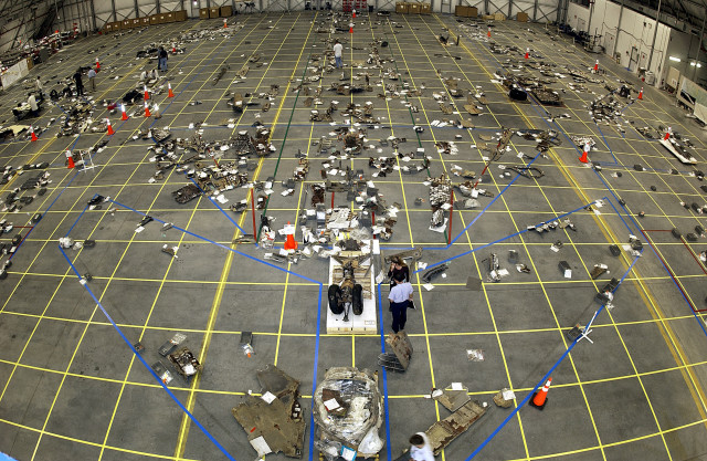 The grid on the floor of the RLV Hangar as workers in the field bring in pieces of Columbia's debris.