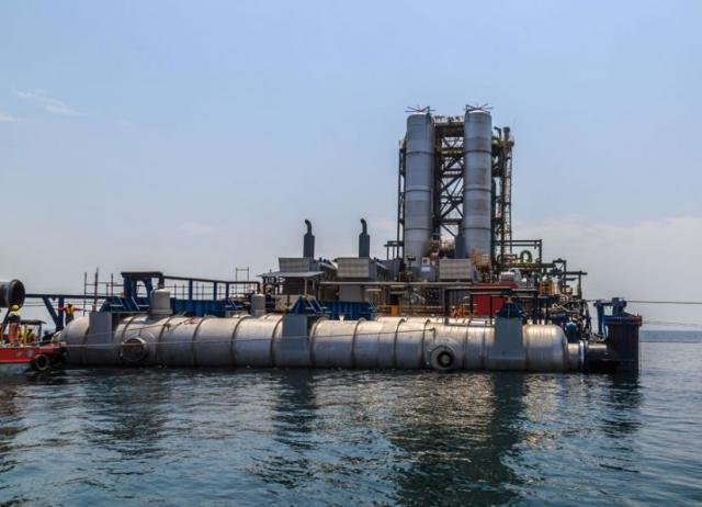 The KivuWatt Barge extracts methane gas and delivers it to a power plant on shore. (Image courtesy of Jason Florio.)