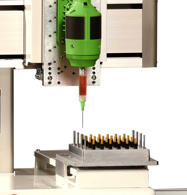 The SmartDispenser LC Fiber Optic Connector Benchtop Automation System by Fishman Corporation.