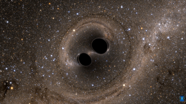 Computer simulation depicting two black holes colliding. (Image courtesy of SXS.)