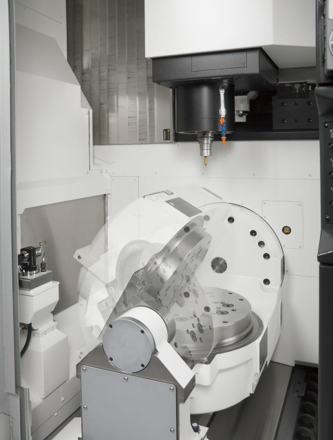 Inside view of the trunnion table of an Okuma MU-4000V 5-axis CNC machine