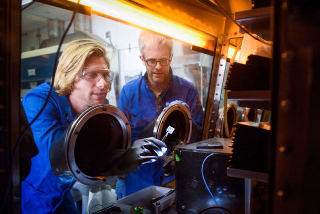 Stanford post-doctoral scholar Tomas Leijtens and Professor Mike McGehee examine perovskite tandem solar cells. (Image courtesy of L.A. Cicero.)