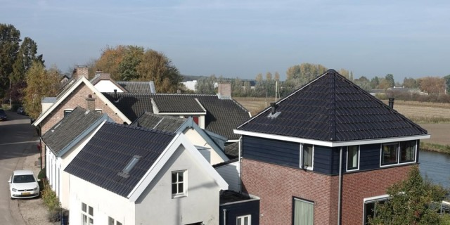 The solar roof tiles work around obstacles like chimneys and skylights. (Image courtesy of ZEP B.V.)