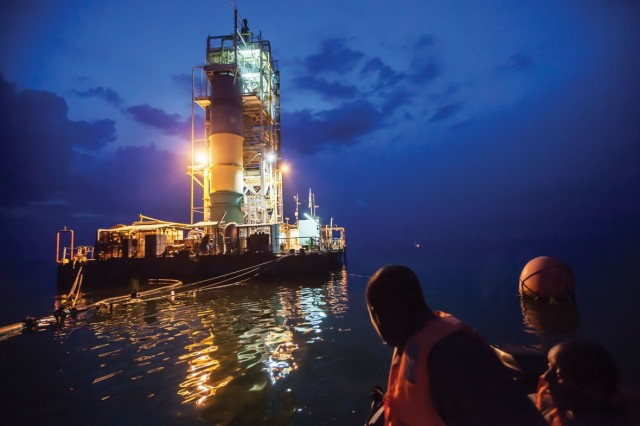 A barge floats on Lake Kivu. It extracts methane for electric power. (Image courtesy of Jason Florio.)