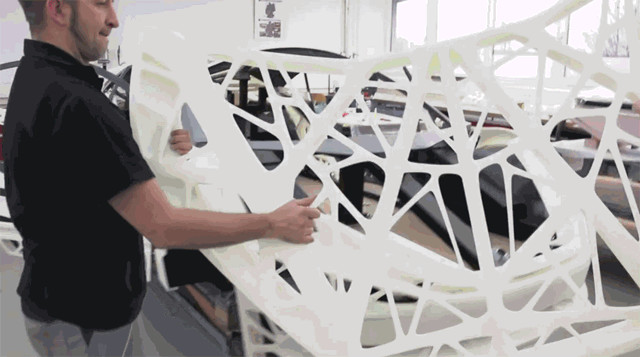 The shell of the Light Cocoon was 3D printed with robotmech's large-scale stereolithography systems. (Image courtesy of EDAG/YouTube.)