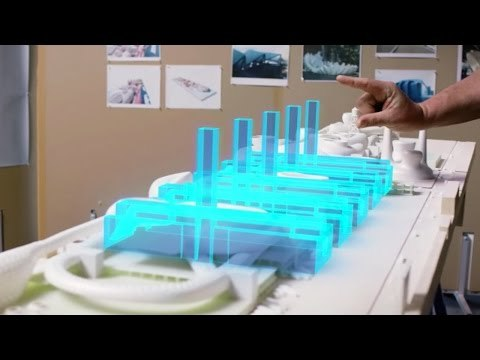 A picture of a Microsoft HoloLens user overlaying a digital model onto a physical one for visualization purposes. (Image courtesy of Microsoft.)