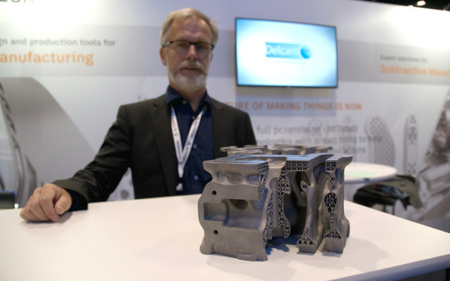 Ulf Lindhe, lead of business development for additive manufacturing with Autodesk, and a 3D-printed engine component optimized for 3D printing using Netfabb.