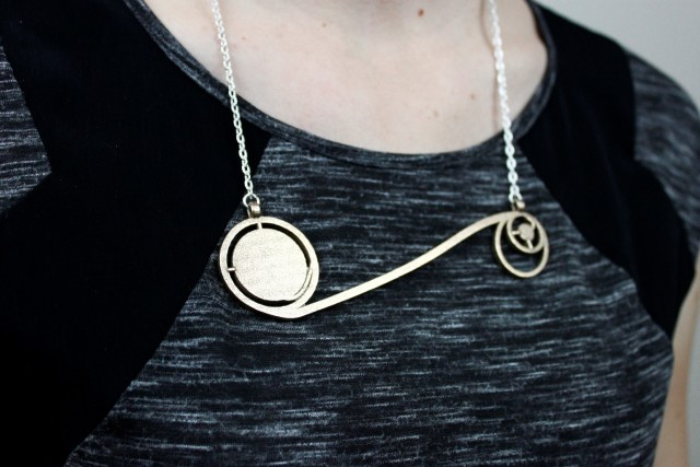 Figure 1.The 3D-printed Apollo 11 Trajectory Necklace was one of Sci Chic's first big hits. It convinced founder and mechanical engineer Erin Winick that combining her passion for science, engineering and fashion was a viable business model. (Image courtesy of Sci Chic.)