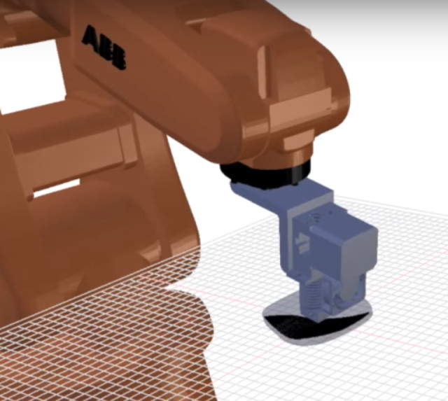 Arevo Labs 3D printer uses a robotic arm to make a carbonfiber part.