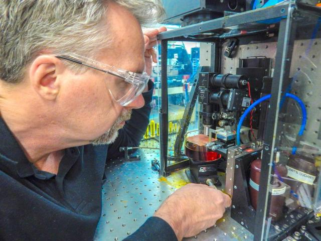 LLNL's Bryan Moran with a LAPuSL machine, of which he is the primary inventor. (Image courtesy of Julie Russell/LLNL.)