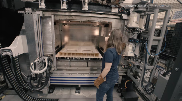 Within the oven, a 3D-printed aircraft panel. (Image courtesy of Stratasys/YouTube.)