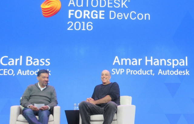 Why is this man smiling? Carl Bass, CEO of Autodesk (right), tells Amar Hanspal, SVP product manager at Autodesk, that VR's day has come—finally.
