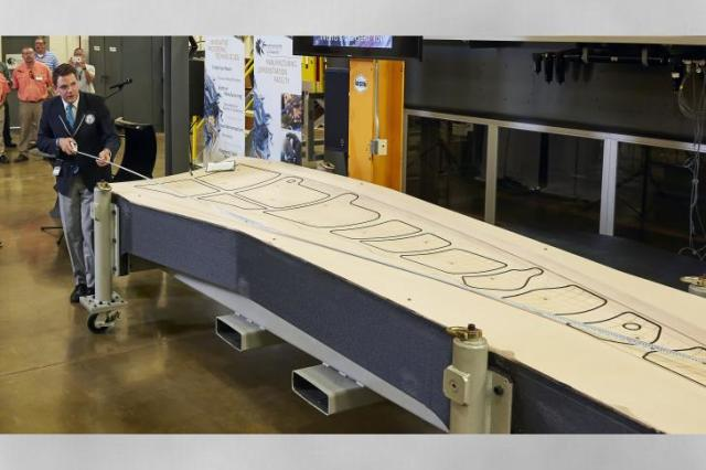 Guinness World Records judge Michael Empric measures the 3D-printed tool. (Image courtesy of ORNL.)