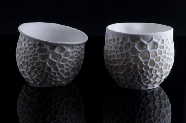 On the left, a 3D-printed cup that experienced slumping during firing. On the right, a cup that experienced cracking during firing. (Image courtesy of Nervous System.)