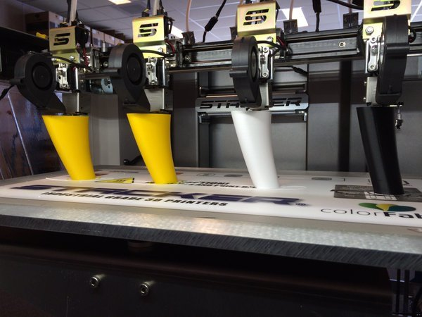 The Stacker S4 allows simultaneous 3D printing of four copies of the same object with different materials. (Image courtesy of Stacker.)
