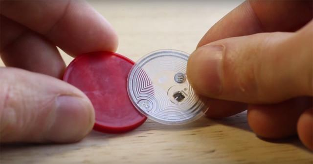 An NFC chip is inserted into the tag midway during the printing process. (Image courtesy of Autodesk/YouTube.)