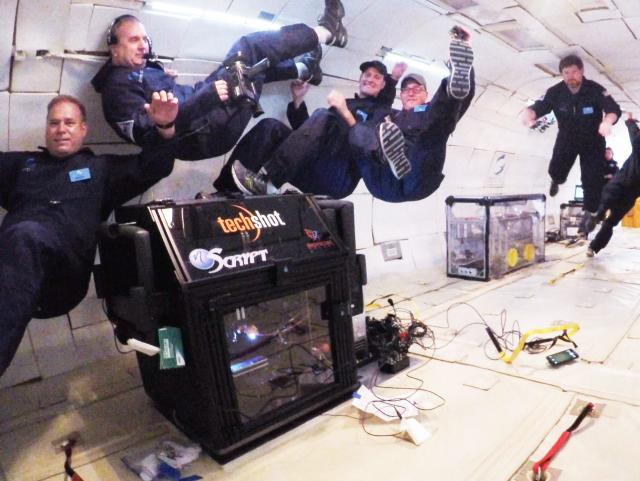 The tech partners performing the bioprinting experiment during a parabolic flight. (Image courtesy of Techshot.)