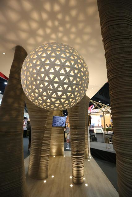 The cave features six 3D-printed concrete columns and a 3D printed lamp. (Image courtesy of WASP.)