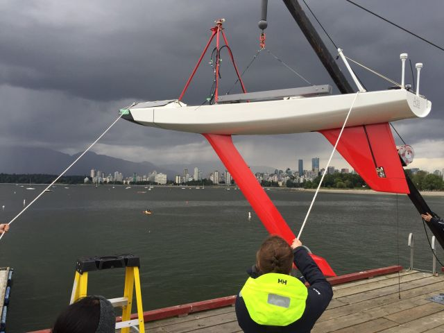 "Figure 3.Ada was tested extensively in her home waters on the Pacific coast before attempting a Trans-Atlantic crossing. This photo shows MadieMelcer, mechanical team co-lead, hoisting Ada and the long, red keel that kept her upright through four months of North Atlantic storms. ""We got the keel right … Satellite transmissions require a clear view of the sky, so the boat needs to be sufficiently upright,"" said team co-captain Serena Ramley. (Image courtesy of the UBC Sailbot team.)"
