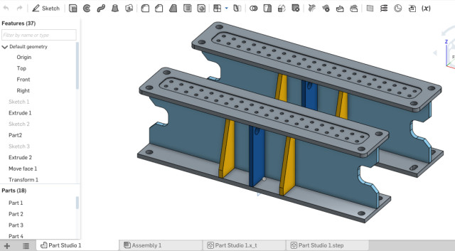 Onshape's design window.A classic feature tree on the left and design window on the right. All the menu options are splattered at the top of the screen.