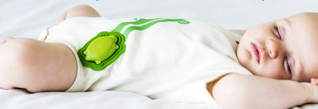A baby sleeping soundly with the turtle-shaped Mimo breathing monitor. (Image courtesy of Mimo).