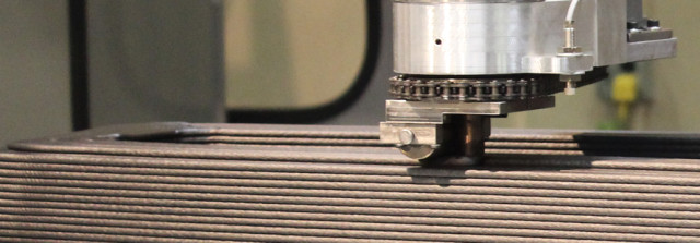 A built-in roller on the LSAM's extruder compresses the material as it's printed. (Image courtesy of Thermwood.)