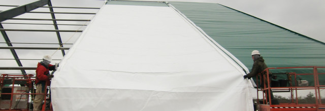 Installing fabric roof panels on a Legacy fabric structure. (Image courtesy of Legacy Building Solutions.)