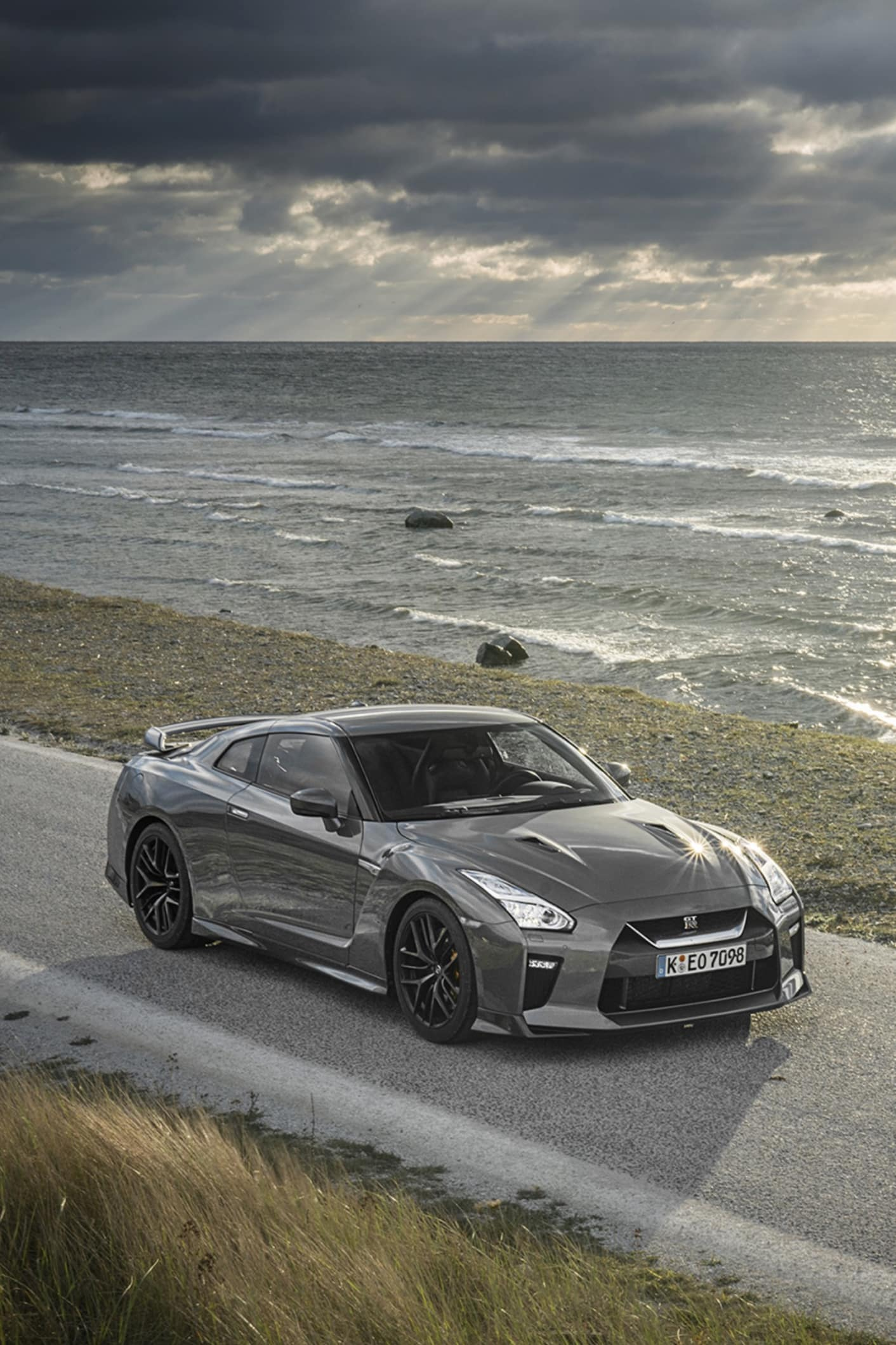 Nissan GT R on a lone coastal road somewhere on Gotland on a fantastic October evening.