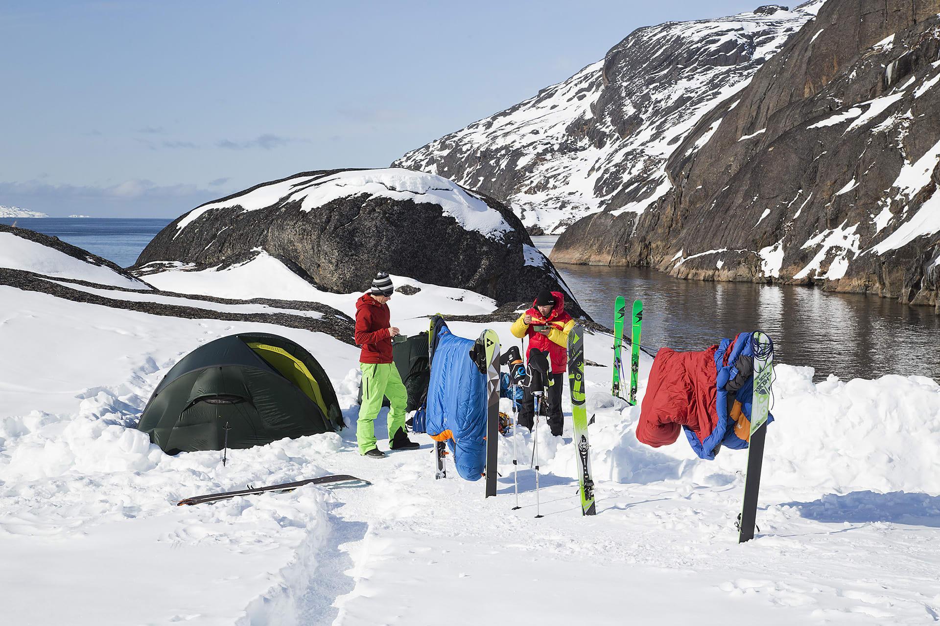 Johan Engebratt, Martin Letzter and Tom Seeman drying clothes in the base camp.