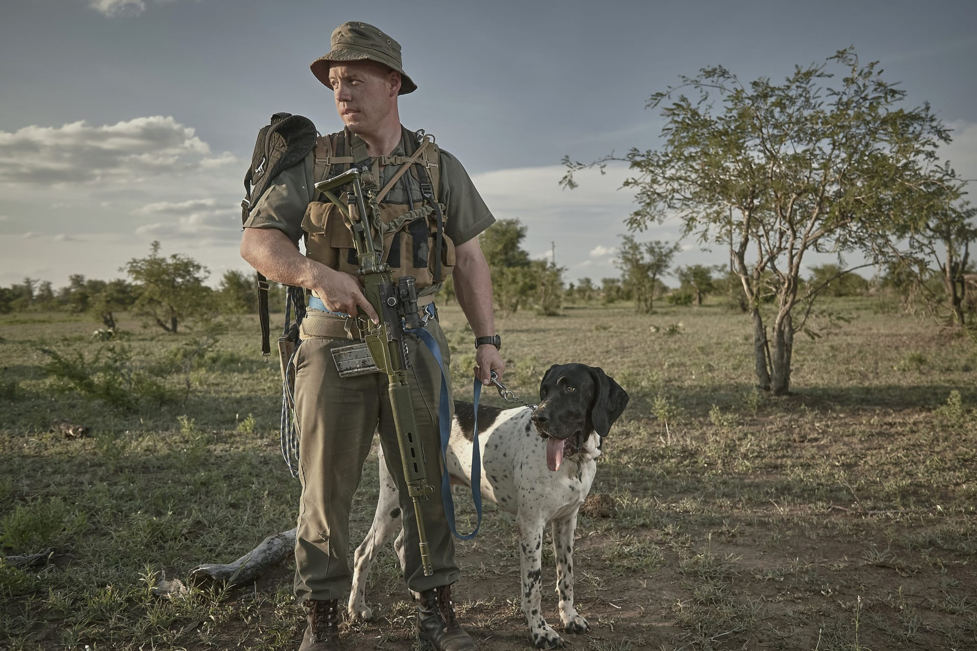 Ranger with tracking dog - tracking and apprehending a poacher before he has committed an offence will save a rhino, while tracking and capturing him after the bloody act can lead to valuable intelligence and ultimately criminal prosecution.