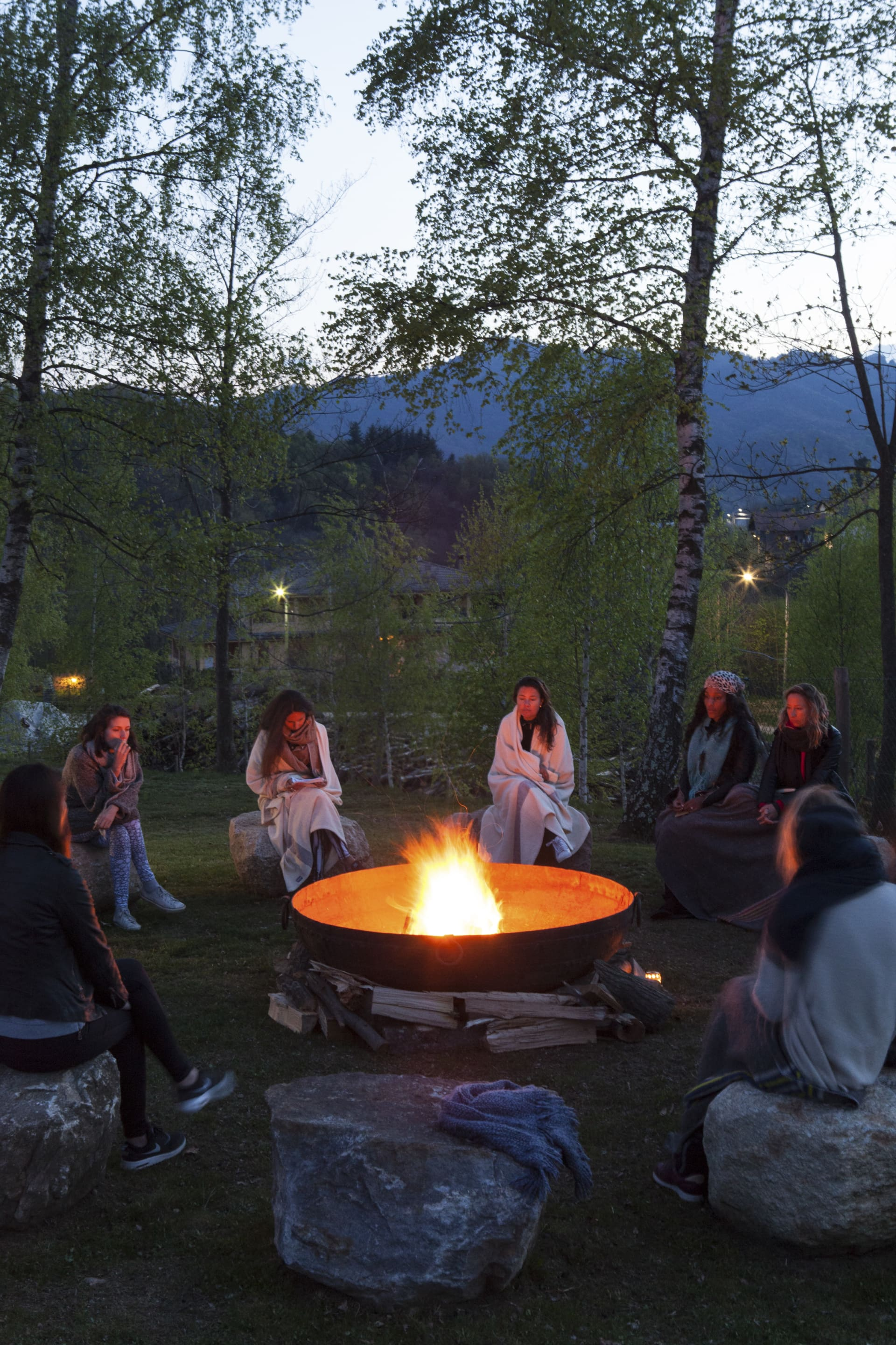 Full moon celebration at the fireplace with the small village of Quarna Sopra on the background.
